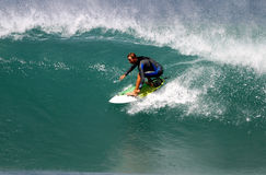 Surfer Shane Beschen surfant en Hawaï Photos stock