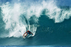 Surfer Shane Dorian Surfing Pipeline in Hawaii stock photo