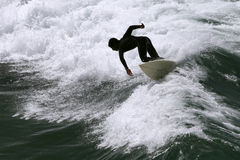 Surfer Silhouette. A surfer is silhouetted in the waves royalty free stock photo