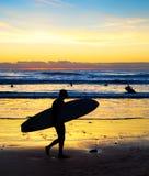 Surfer silhouette beach sunset Bali royalty free stock photos