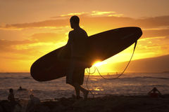 Surfer silhouette at sunset Royalty Free Stock Image