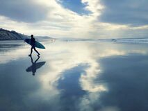 Surfer Silhouette, Vibrant Sky Ocean Reflections