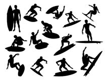 Surfer Silhouettes Detailed. A set of high quality detailed silhouettes of a surfer surfing the waves on his surfboard stock illustration