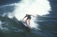 Surfer in small wave Royalty Free Stock Photos