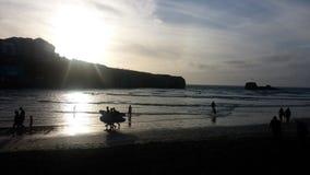 Surfer-Sonnenuntergang lizenzfreie stockfotos