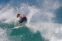 Surfer Spray. A Surfer Rides A Wave While Surfing In Honolulu, Hawaii Stock Photos