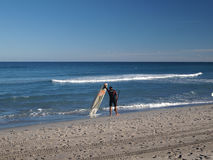 Surfer standing on the beach royalty free stock photo