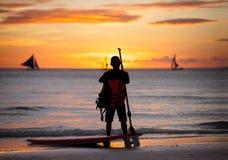 Surfer standing next surfboard Stock Photo