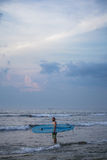 Surfer standing in water Stock Photography