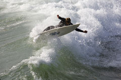 Surfer Stretch. A surfer stretches to stay on board royalty free stock photos