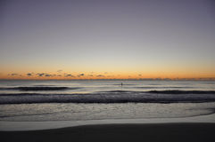 Surfer Sunrise over the Ocean Stock Photo