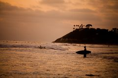 A surfer at sunset Royalty Free Stock Images