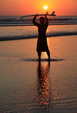 Surfer on sunset royalty free stock image