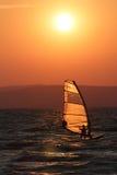 Surfer in the sunset at Balaton Stock Photos