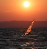 Surfer in the sunset at Balaton Stock Images