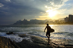 Surfer at sunset in Ipanema beach. Surf at sunset in Arpoador beach at Ipanema in Rio de Janeiro Stock Photography