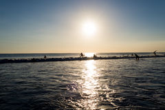 Surfer at sunset in Kuta beach , Bali. Indonesia royalty free stock photo