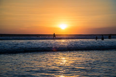 Surfer at sunset. In Kuta beach , Bali , Indonesia royalty free stock image