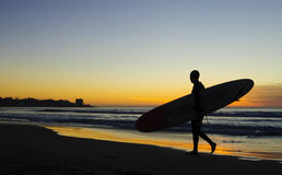 Surfer at Sunset, La Jolla shores. San Diego, California Royalty Free Stock Image