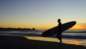 Surfer at Sunset, La Jolla shores. San Diego, California Royalty Free Stock Photography