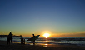 Surfer at Sunset, La Jolla shores. San Diego, California Stock Photography