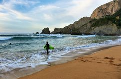 Surfer at sunset in Laga beach, Basque country, spain. stock photos