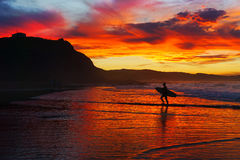 Surfer at sunset in Sopelana beach. Surfer at sunset in the Sopelana beach royalty free stock image