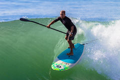 Surfer SUP Riding Wave. Surfing sup  rider on a good fun wave Stock Images