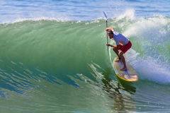 Surfer SUP Wave Curl. Surfing sup rider on a good size wave in the pocket Royalty Free Stock Image
