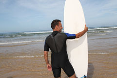 Surfer with surfboard Royalty Free Stock Photos