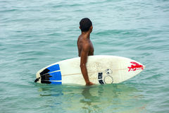 Surfer with surfboard in the ocean Stock Image