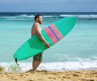 Surfer with surfboard in the ocean Stock Photos