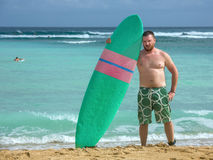 Surfer with surfboard in the ocean Royalty Free Stock Photography
