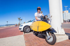 Surfer Surfboard Scooter Motor Bike Royalty Free Stock Photography