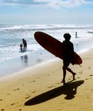 Silhouette of surfer on beach Stock Photos