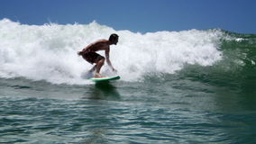 Surfer surfing stock video footage