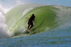 Surfer Surfing a Tubing Wave Royalty Free Stock Images