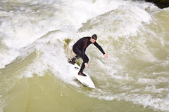 Surfer surfs at the Isar in huge Royalty Free Stock Images