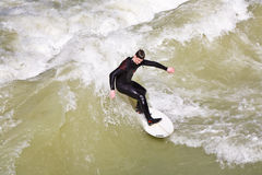 Surfer surfs at the Isar in huge Royalty Free Stock Photos