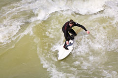 Surfer surfs at the Isar in huge Royalty Free Stock Photography