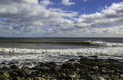 Surfer surfs a perfect wave on a sunny day Stock Photography