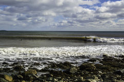 Surfer surfs a perfect wave on a sunny day Royalty Free Stock Photography