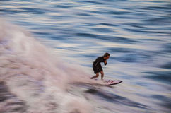 Surfer taking his last ride in Royalty Free Stock Image
