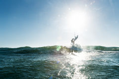 Surfer taking off stock photo