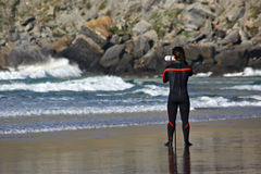 Surfer taking pictures Stock Photo