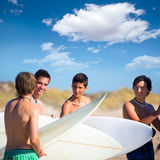 Surfer teen boys talking on beach shore. Holding surfboards Royalty Free Stock Photography
