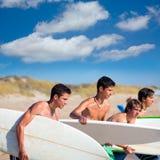 Surfer teen boys talking on beach shore. Holding surfboards Royalty Free Stock Photo