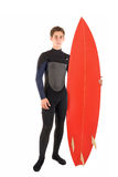 Surfer. Teenager in wet suit with surf board posing isolated in white Stock Photography