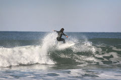 Surfer on top of the wave Royalty Free Stock Photos