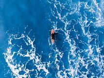 Surfer top of wave in ocean, top view aeria. Surfer wave in ocean, top view aerial photo, tropical water stock photography
